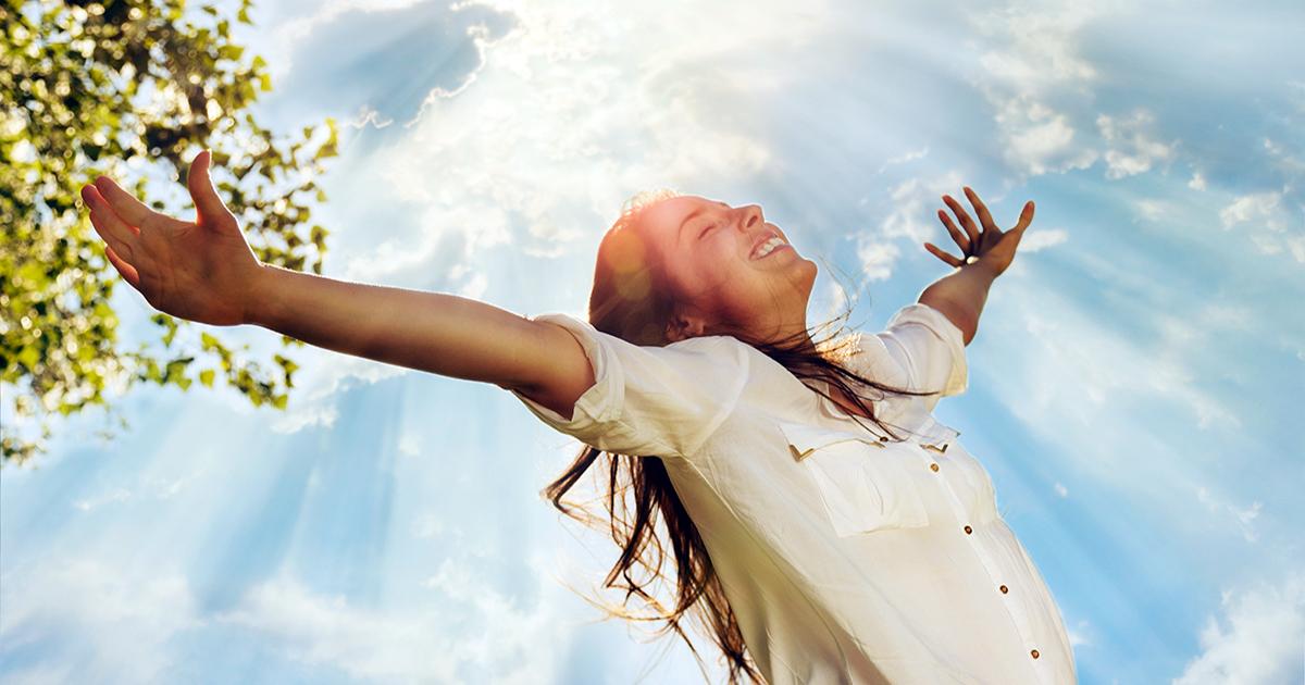 woman celebrating sunshine